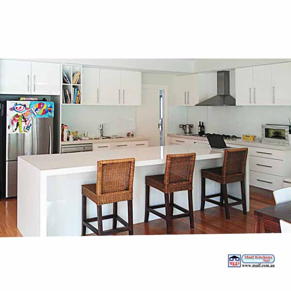 White kitchen on timber floor with island and glass splashback