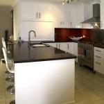 White kitchen with red glass splashback