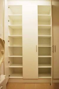 White door laundry cabinet